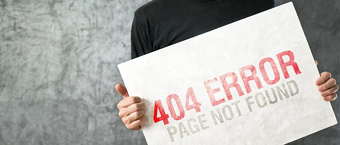 "Website Outsourcing in Montgomery, AL - man holding large sign that reads ""404 Error"""